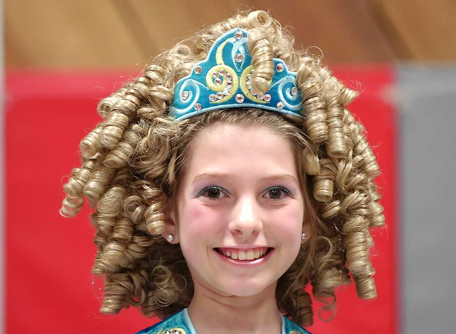 Hannah Coyman, of the Lynn Academy of Irish Dance of Stamford, models her blonde curls that are part of a wig and traditional head-dress for the costume female Irish dancers wear on March 11, 2008. Photo: Bob Luckey / File Photo
