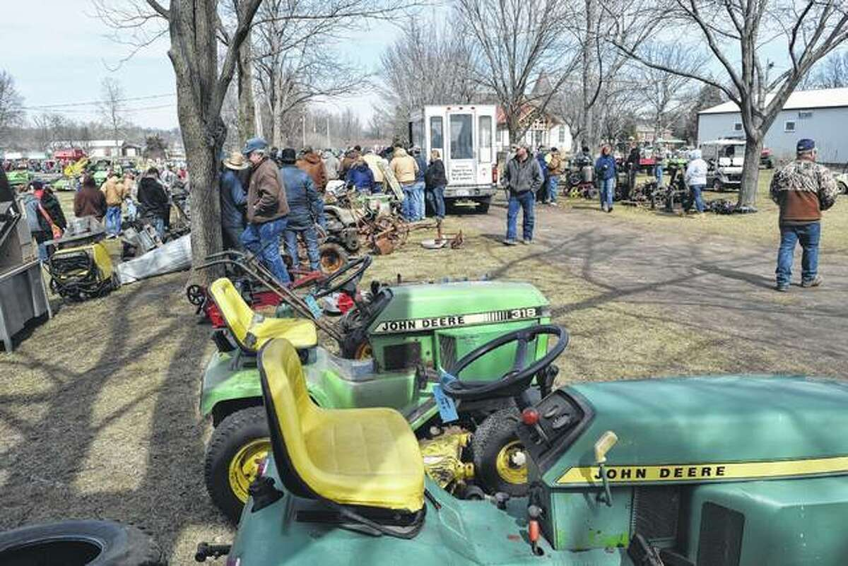 Hundreds of people bought and sold farm equipment and miscellaneous items Saturday at Prairie Land Heritage Museum's 14th annual public consignment auction in South Jacksonville.