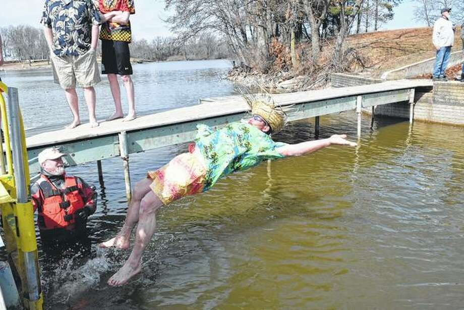 Cameron Turner of Jacksonville falls back into the 45-degree waters of Lake Jacksonville Saturday during Hobby Horse House of Jacksonville's Polar Plunge, a fundraiser for the child welfare agency. At left is Bruce Selway, a member of the Jacksonville/Morgan County Underwater Search and Rescue Dive Team. Photo: Greg Olson | Journal-Courier