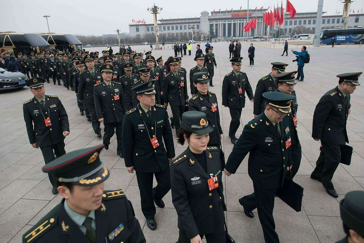 Military delegates arrive before a vote on constitutional amendments at the National People's Congress in the Great Hall of the People in Beijing on March 11, 2018. China's parliament voted on March 11 to abolish presidential term limits, clearing the path for President Xi Jinping to rule for life. / AFP PHOTO / NICOLAS ASFOURINICOLAS ASFOURI/AFP/Getty Images