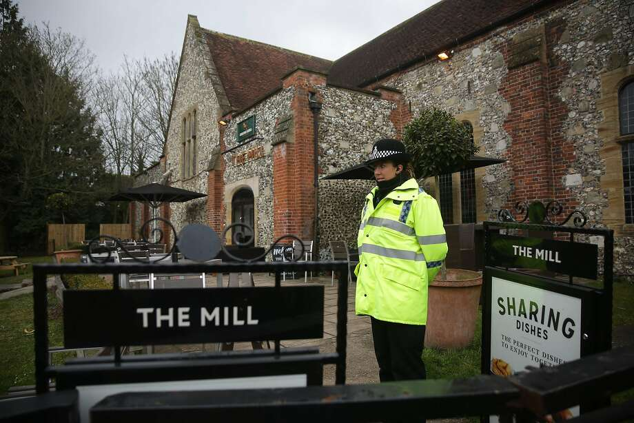 A police officer stand in front of a cordon in front of The Mill pub in Salisbury, southern England, on March 11, 2018, as investigations continue in connection with the major incident sparked after a man and a woman were apparently poisoned in a nerve agent attack a week ago. British police hunting the perpetrators behind a nerve agent attack on a Russian former spy are examining more than 200 pieces of evidence, London said after a meeting of the UK's national emergencies committee. Counter-terror police had identified more than 240 witnesses, the Home Office interior ministry said after a meeting of the committee known as COBRA, chaired by Home Secretary Amber Rudd.  / AFP PHOTO / Daniel LEAL-OLIVASDANIEL LEAL-OLIVAS/AFP/Getty Images Photo: DANIEL LEAL-OLIVAS, AFP/Getty Images