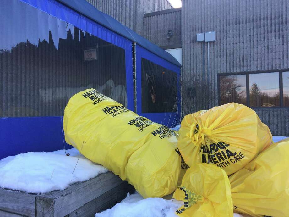 Bags of material generated in a hazmat incident sit near an entrance of the U.S. Postal Service facility on Karner Road in Colonie, Sunday, March 11, 2018. Three workers were treated for rashes. But what caused their ailment is still unknown. (Lauren Stanforth/Times Union)