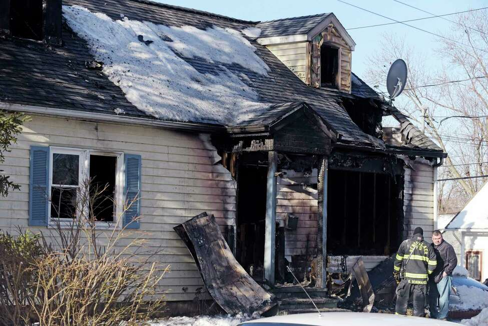 A view of the home at 900 Mann Ave., as the investigation continues into an early morning fire on Sunday, March 11, 2018, in Rensselaer, N.Y. (Paul Buckowski/Times Union)