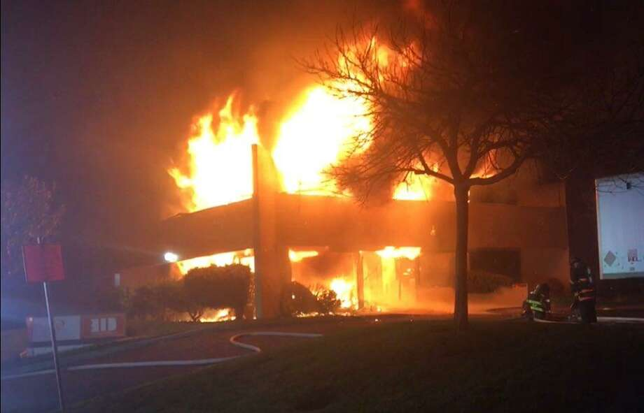 Flames engulf a commercial building early Sunday in Vallejo.