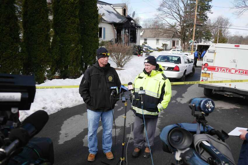 Rensselaer Police Detective, Scott Earing, left, and Rensselaer Assistant Fire Chief, Jay Cocoran talk to members of the media near the home at 900 Mann Ave., as the investigation continues into an early morning fire on Sunday, March 11, 2018, in Rensselaer, N.Y. (Paul Buckowski/Times Union)