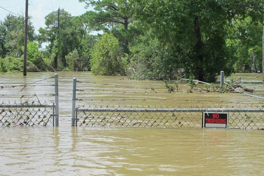 FILE - In this Aug. 31, 2017 file photo, a barbed-wire fence encircles the Highlands Acid Pit that was flooded by water from the nearby San Jacinto River as a result from Harvey in Highlands, Texas.  Floodwaters have inundated at least five highly contaminated toxic waste sites near Houston, raising concerns that the pollution there might spread. (AP Photo/Jason Dearen) Photo: Jason Dearen, STF / Associated Press / Internal