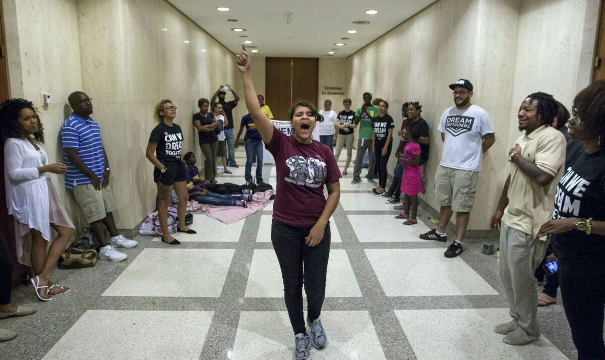 Annie Thomas leads a group of the Dream Defenders in the hallway outside Gov. Rick Scott's office in Tallahassee, Fla., Aug. 5, 2013. Formed after the death of Trayvon Martin, the group remains ensconced in the state's Old Capitol building, demanding changes to Florida's self-defense laws, specifically, the Stand Your Ground provision, and in the way minorities are treated in the state's schools and on the streets. (Mark Wallheiser/The New York Times)