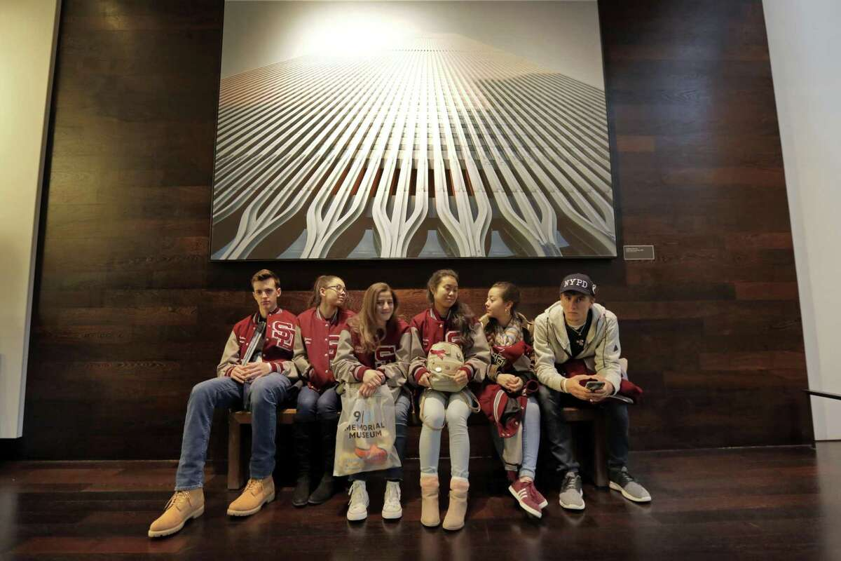 Students from Marjory Stoneman Douglas High School Wind Symphony, in Parkland, Fla., take a break after their tour of the 9/11 Museum, in New York, Wednesday, March 7, 2018. The group, who had planned the trip before the Feb. 14 rampage at their school, toured the museum that commemorates the deadliest act of terrorism on U.S. soil. (AP Photo/Richard Drew)