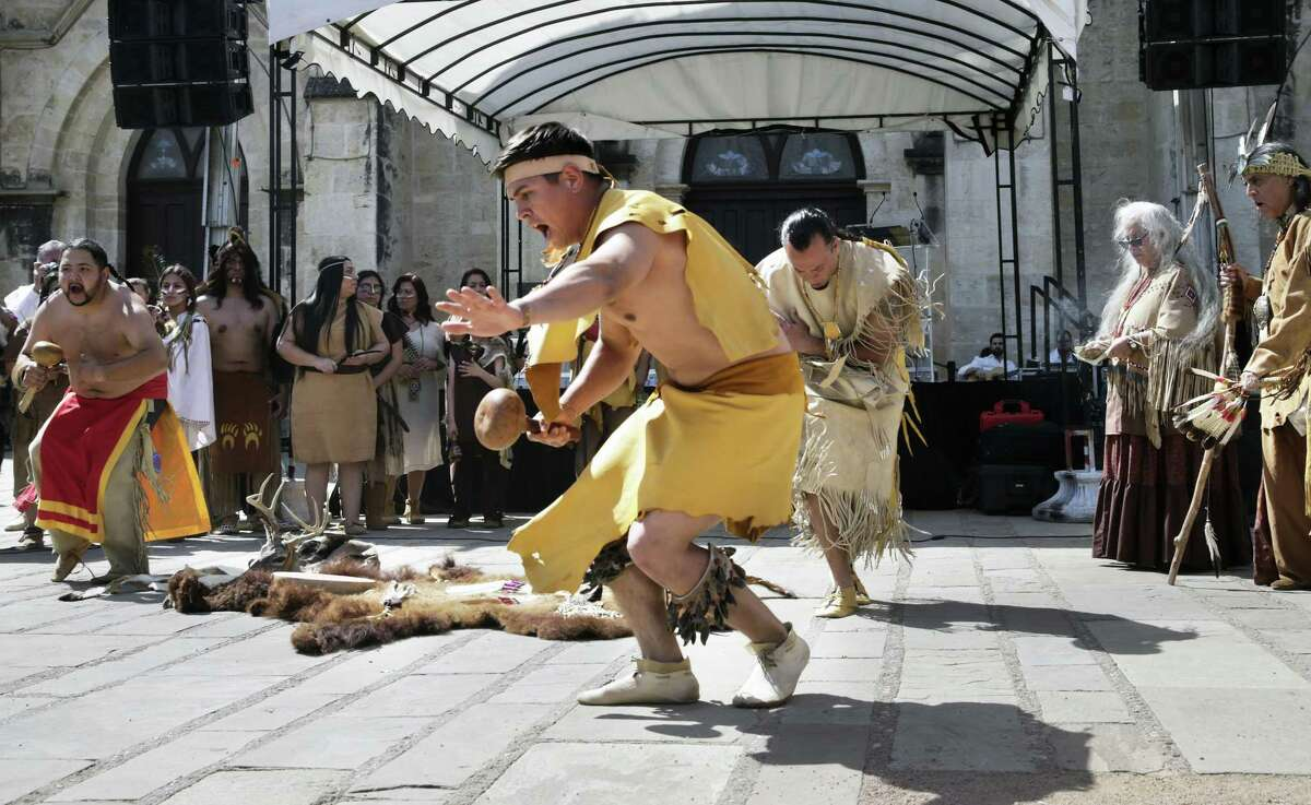 Descendents of native Americans perform ceremonies as historical and genealogical organizations present