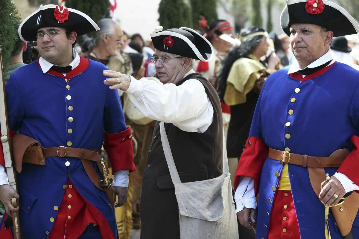 Spanish soldier wait for proceedings to begin as historical and genealogical organizations present