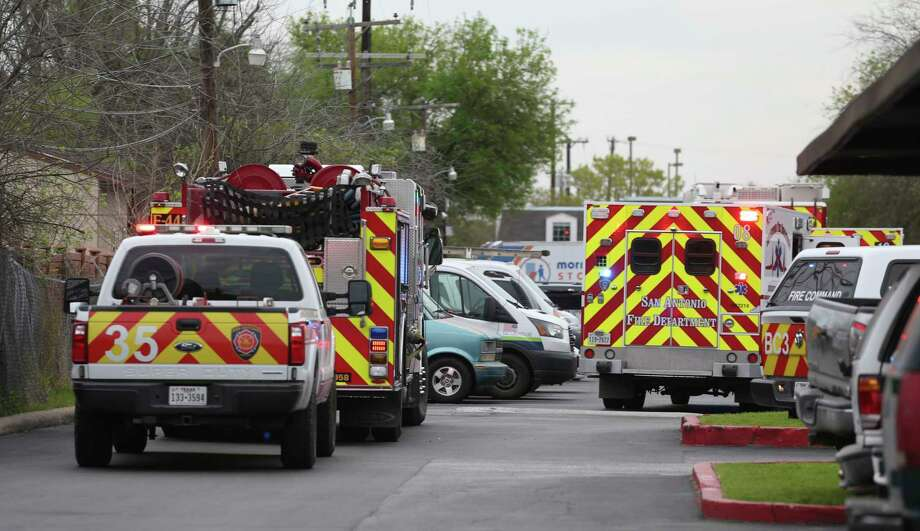 San Antonio firefighters respond to a carbon monoxide leak Saundy morning, March 11, 2018, at the Marbach Manor apartments on the West Side. Five people were hospitalized including a 3-month-old. A total of 18 units with about 30 people were evacuated. Photo: JERRY LARA, San Antonio Express-News / © 2018 San Antonio Express-News