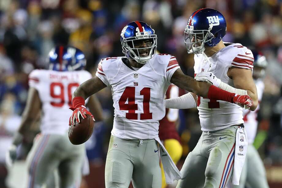 LANDOVER, MD - JANUARY 01: Cornerback Dominique Rodgers-Cromartie #41 of the New York Giants celebrates with teammate outside linebacker Mark Herzlich #94 after intercepting the ball against the Washington Redskins in the fourth quarter at FedExField on January 1, 2017 in Landover, Maryland. (Photo by Rob Carr/Getty Images) Photo: Rob Carr/Getty Images