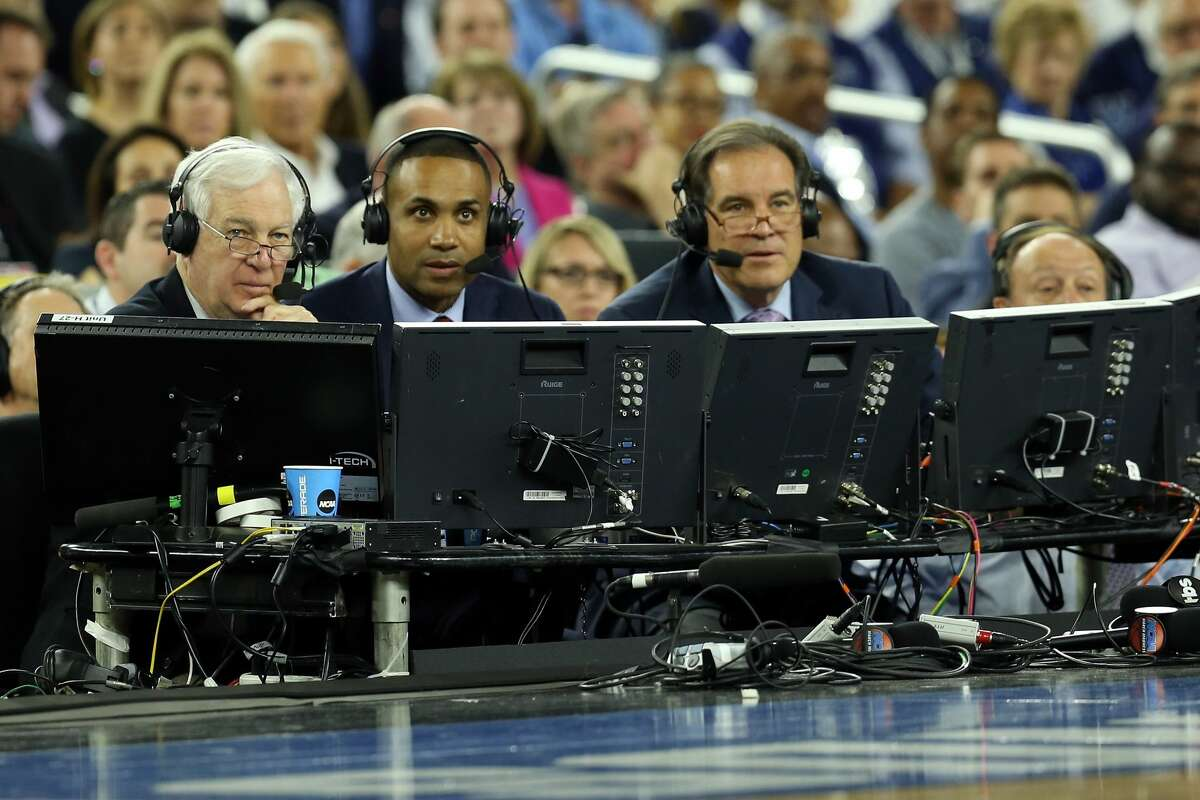 HOUSTON, TEXAS - APRIL 02: The broadcasters Bill Raftery, Jim Nantz and Grant Hill speak during the NCAA Men's Final Four Semifinal at NRG Stadium on April 2, 2016 in Houston, Texas. (Photo by Streeter Lecka/Getty Images)