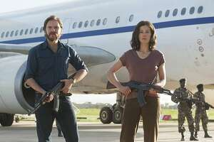 Daniel Bruhl and Rosamund Pike in '7 Days in Entebbe'