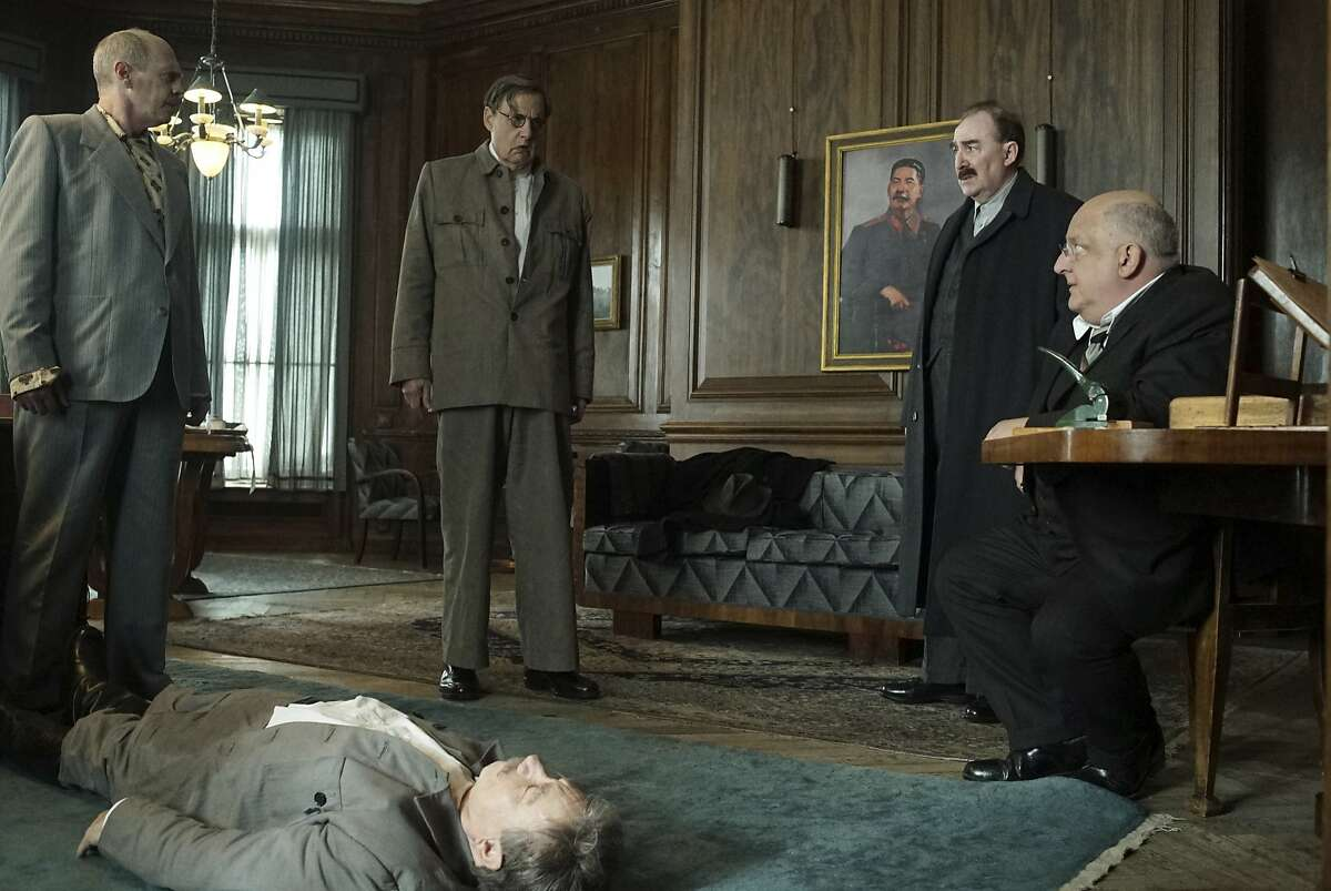 """This image released by IFC Films shows, from left, Steve Buscemi, Adrian McLoughlin, Jeffrey Tambor, Dermot Crowley and Simon Russell Beale in a scene from """"The Death of Stalin."""" (Nicola Dove/IFC Films via AP)"""