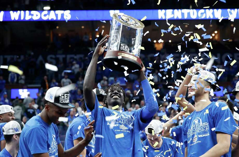 ST LOUIS, MO - MARCH 11:  Wenyen Gabriel #32 of the Kentucky Wildcats holds the winner's trophy after the 77-72 win over the Tennessee Volunteers in the Championship game of the 2018 SEC Basketball Tournament at Scottrade Center on March 11, 2018 in St Louis, Missouri. Photo: Andy Lyons, Getty Images / 2018 Getty Images