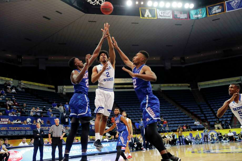 Georgia State forward Malik Benlevi (2) shoots between Texas-Arlington forward Kevin Hervey, right, and center Link Kabadyundi (22) in the first half of the the Sun Belt Conference NCAA college basketball championship game in New Orleans, Sunday, March 11, 2018. (AP Photo/Gerald Herbert) Photo: Gerald Herbert, Associated Press / Copyright 2018 The Associated Press. All rights reserved.