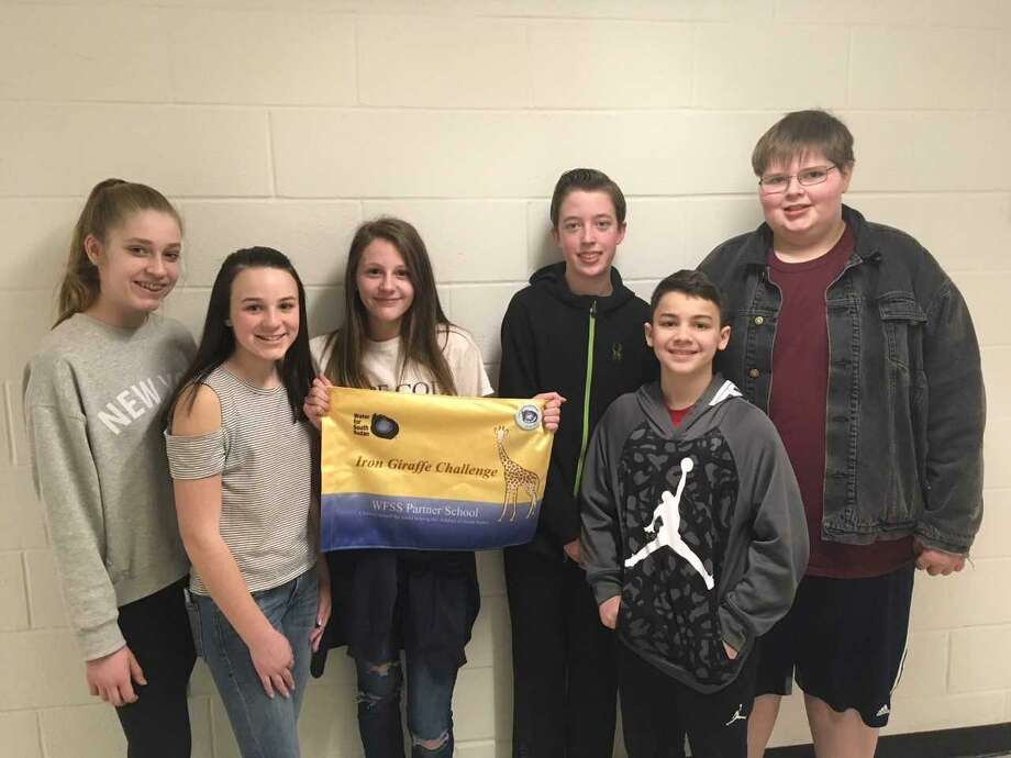 From left, Sally Morbidelli, Sophia Page, Lillian Kaempffer, Christopher Carlson, John Lorenti and Jack Clini, students from Amity Middle School in Orange, are raising money for Water for South Sudan, a nonprofit organization that drills wells to provide safe drinking water for people in South Sudan. Photo: Amity Middle School Principal Kathy Burke / Contributed Photo /
