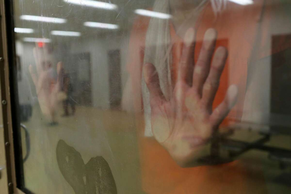 In a Mental Health Unit pod, an inmate is kept under suicide watch in at the Bexar County Jail, Monday, July 18, 2016. The pod is reserved for inmates who pose no threat to others. Upon intake, inmates are evaluated for mental and physical health problems before being released into the jail population. Between the beginning of the year and July 14 there have been 924 suicide attempts at the jail. Three inmates have died as a result, all in the last three weeks.