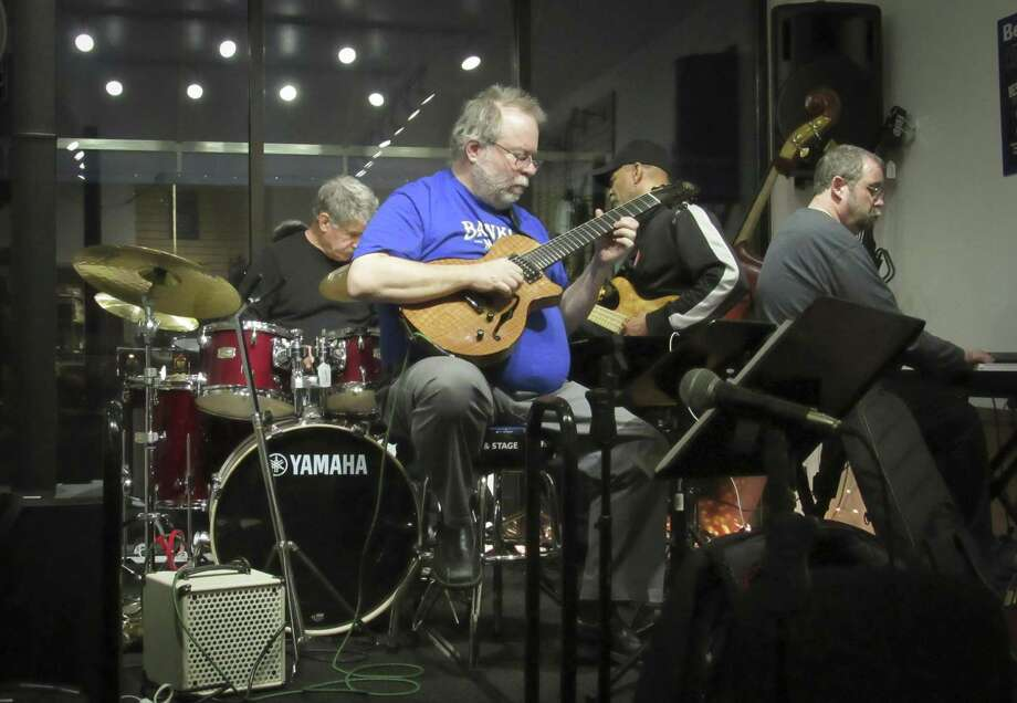 Joe Shapiro, Banko's owner, plays guitar during the March 6 open mic jam session. Photo: / Contributed Photo