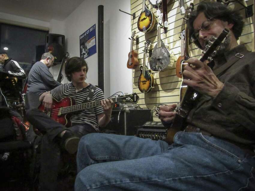 James Rafferty, a high school student, playing bass and Tom Stio on electric mandolin perform during the March 6 open mic jam session at Banko's 360 East Main Street in Ansonia