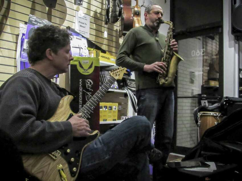 Ed Chervansky playing guitar and Larry Haddad on sax jam at the March 6 open mic session at Banko's, 360 East Main Street, Ansonia