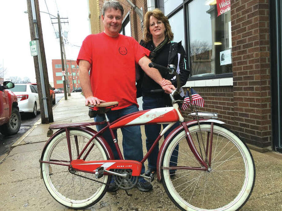 Steve and Gail Gray of Glen Carbon with an antique bicycle. Photo: Steve Horrell | For The Telegraph