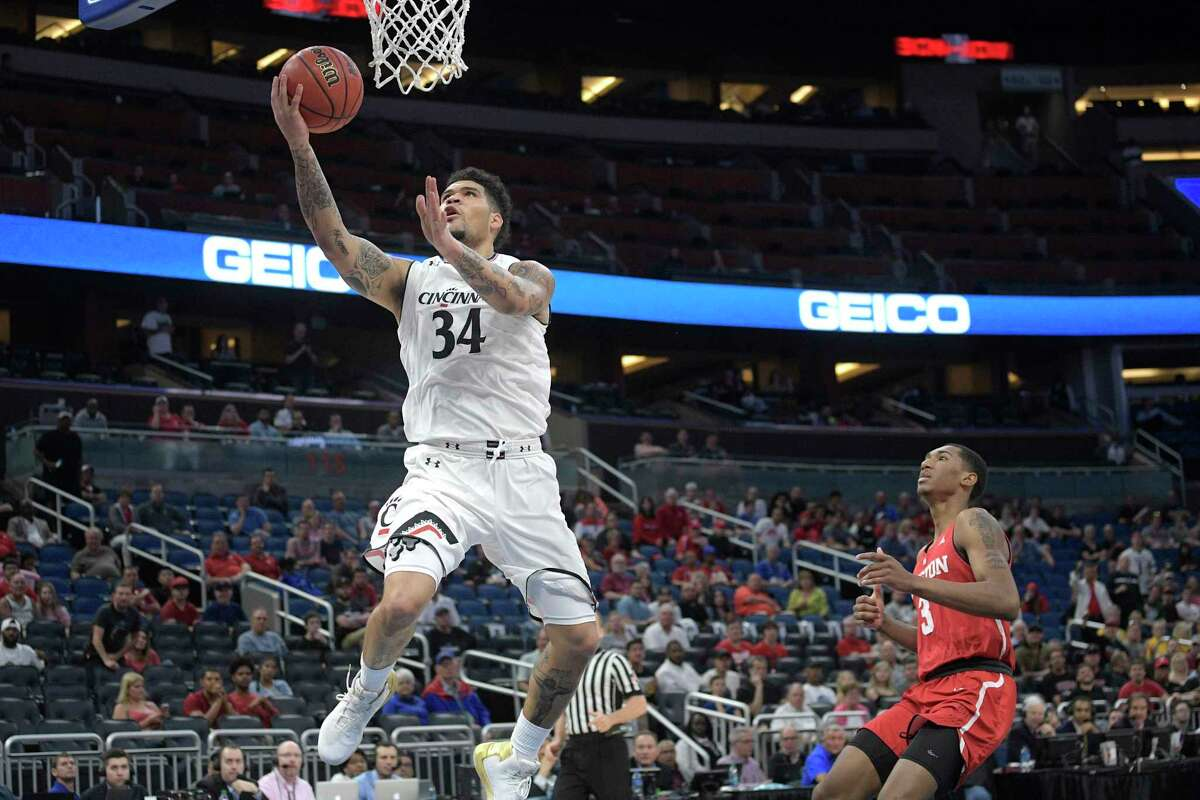 Cincinnati guard Jarron Cumberland (34) goes up for a shot in front of Houston guard Armoni Brooks (3) during the first half of an NCAA college basketball championship game at the American Athletic Conference tournament Sunday, March 11, 2018, in Orlando, Fla. (AP Photo/Phelan M. Ebenhack)