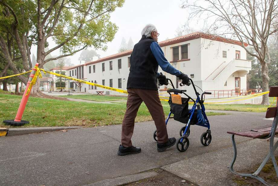 "Veterans Home of California resident Chuck Marlotta, 93, who served during WWII, walks passed the Pathway Home in Yountville, where three women were slain Friday. He said a somber mood has been hanging over the community since the tragedy. ""There is just a quietness and a reverence for the three ladies,"" he said. Photo: Peter DaSilva, Special To The Chronicle"