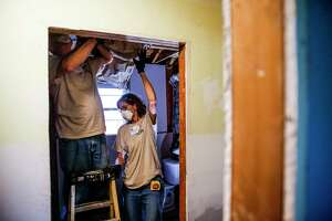 Eight Days of Hope volunteers Max and Donna Zollers work to hang insulation in the bathroom of a home flooded by Hurricane Harvey Saturday, March 10, 2018 in Dickenson. Thousands of volunteers spread out across the Houston area to help more than 500 homeowners repair or rebuild their homes in the wake of the hurricane.