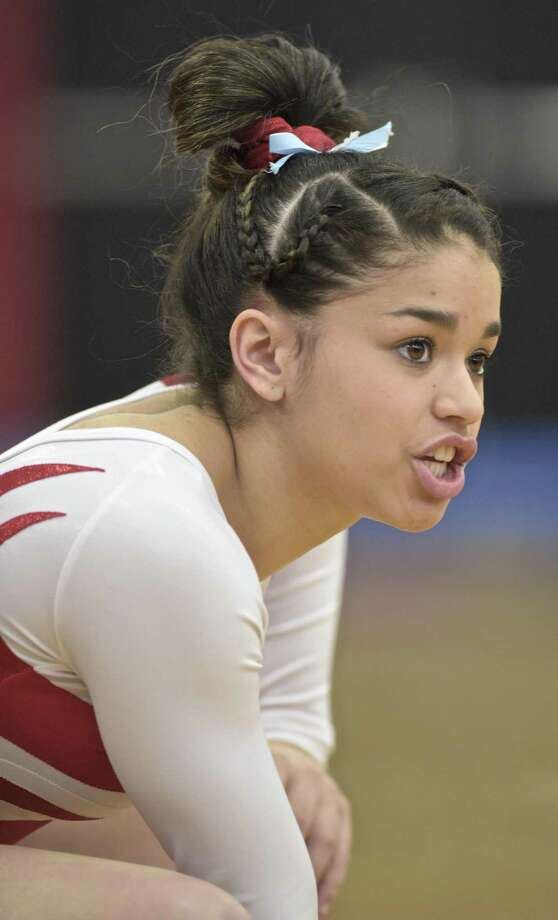 Greenwich's Adnerys De Jesus put the finishing touches on a outstanding career by winning three events on Saturday at the New England Gymnastics Championships. Photo: H John Voorhees III / Hearst Connecticut Media / The News-Times