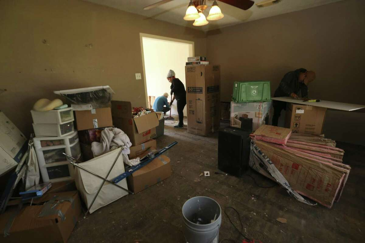 A group of construction workers fix different parts of Tracy Wilson's flooded house on Thursday, March 1, 2018, in Houston. Wilson signed up for Texas Rebuild's PREPS program, which is a FEMA housing program that provides up to $20,000 in repair work for flooded homes, to fix her house. ( Yi-Chin Lee / Houston Chronicle )