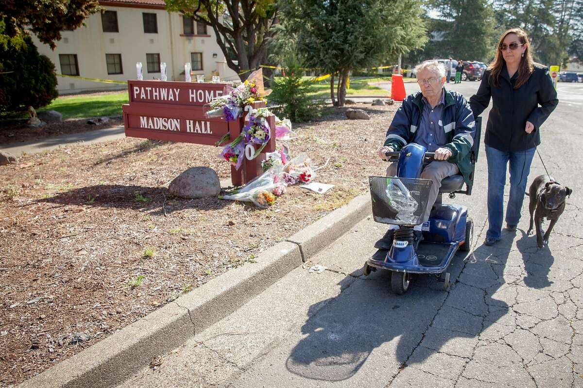 Veteran Home of California resident, Ernest Powell, who served in Korea, with his daughter Tracy, strolls passed a make shift memorial after laying flowers for the three Pathway Home employees that were killed by a former patient on Friday March 09 in Yountville, California, USA 11 Mar 2018.