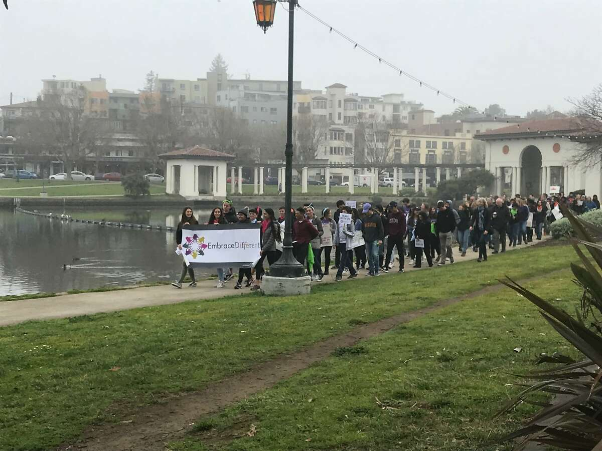 Students march along Lake Merritt on March 11 to speak out against social isolation in schools and support inclusion.