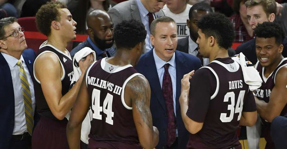 Texas A&M coach Billy Kennedy talks to his team during a time out against Arkansas during the second half of an NCAA college basketball game Saturday, Feb. 17, 2018, in Fayetteville, Ark. (AP Photo/Michael Woods) Photo: Michael Woods/Associated Press