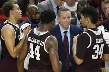 Texas A&M coach Billy Kennedy talks to his team during a time out against Arkansas during the second half of an NCAA college basketball game Saturday, Feb. 17, 2018, in Fayetteville, Ark. (AP Photo/Michael Woods)