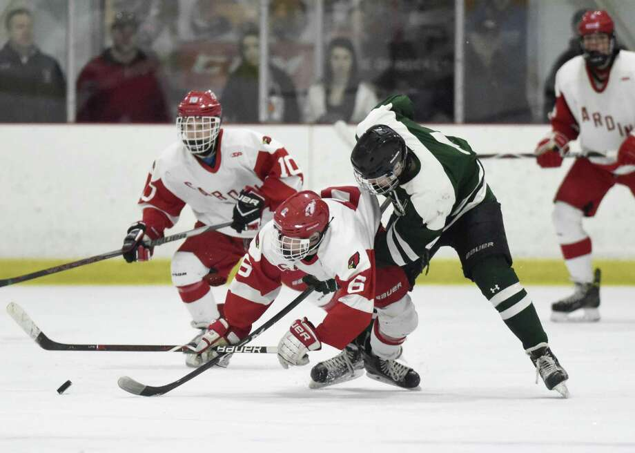 Greenwich's John Lawrence, left, gets tangled up with Northwest Catholic's Paul Arel, leading to a fight and ejection of both players in No. 2 Greenwich's 3-0 win over No. 7 Northwest Catholic in the quarterfinal matchup of the CIAC Division I high school boys hockey tournament at Northfield Ice Pavilion in Northfield, Conn. Sunday, March 11, 2018. Lawrence wll be suspended for Greenwich's next game against No. 3 Xavier. Photo: Tyler Sizemore / Hearst Connecticut Media / Greenwich Time