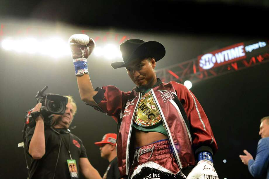 Mikey Garcia gestures before he faces Sergey Lipinets for the IBF junior welterweight title at Freeman Coliseum on Saturday, March 10, 2018. Garcia won by unanimous decision. Photo: Billy Calzada, Staff / San Antonio Express-News / San Antonio Express-News