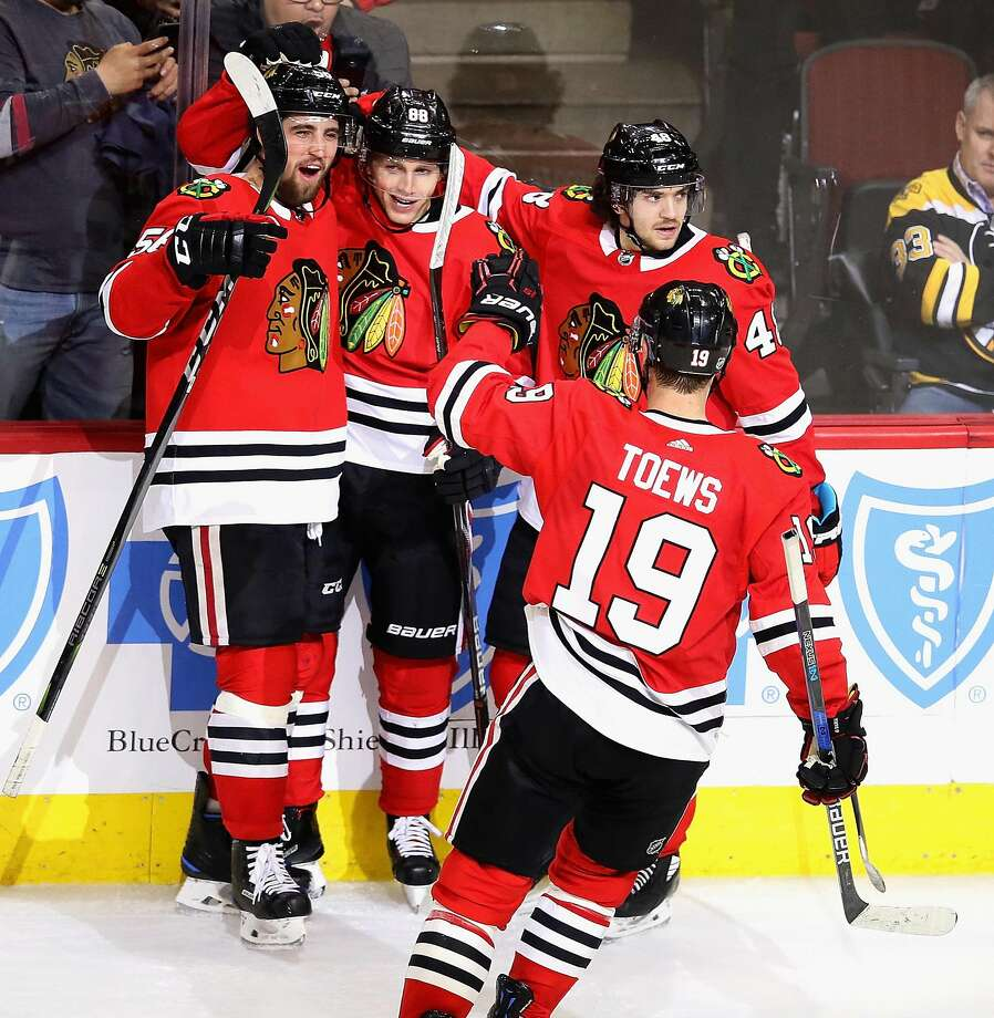 Chicago's Patrick Kane is the center of attention after scoring a tie-breaking goal late in the third period. Photo: Jonathan Daniel, Getty Images