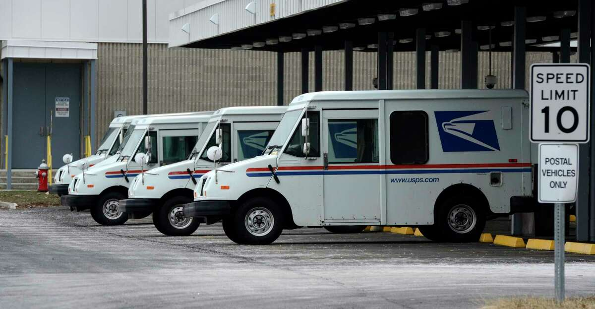 U. S. Mail vehicles sit parked in the U. S. Post Office Processing and Distribution facility Feb. 6, 2013, on Karner Road in Colonie, N.Y. (Skip Dickstein/Times Union)
