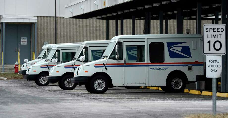 U. S. Mail vehicles sit parked in the U. S. Post Office Processing and Distribution facility Feb. 6, 2013,  on Karner Road in Colonie, N.Y. (Skip Dickstein/Times Union) Photo: SKIP DICKSTEIN
