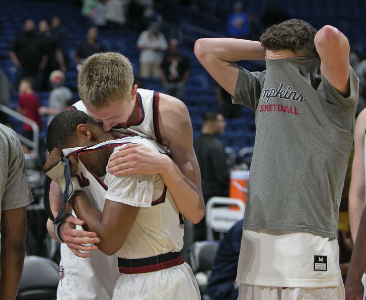 Eden Holt, left, is consoled by Katy Tompkins teammate Kristian Sjolund after the Eagles' 49-47 overtime loss to Allen in the Class 6A state title game Saturday night.