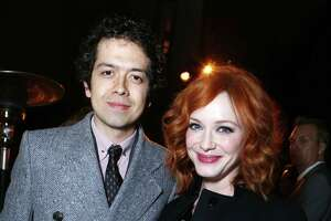 IMAGE DISTRIBUTED FOR AMC -Geoffrey Arend, left, and Christina Hendricks attend the after party for the AMC Season 6 Premiere of Mad Men, on Wednesday, March, 20, 2013 in Los Angeles. (Photo by Alexandra Wyman/Invision for AMC/AP Images)
