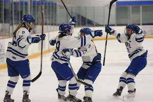 Darien's Kate Bellissimo, second from left; celebrates her first period goal with her teammates in the Blue Wave's 2018 Championship victory over Suffield Co-Op at Bennett Rink in West Haven, Conn. on Sunday, March 11, 2018.