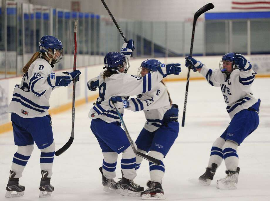 Darien's Kate Bellissimo, second from left; celebrates her first period goal with her teammates in the Blue Wave's 2018 Championship victory over Suffield Co-Op at Bennett Rink in West Haven, Conn. on Sunday, March 11, 2018. Photo: Brian A. Pounds / Hearst Connecticut Media / Connecticut Post