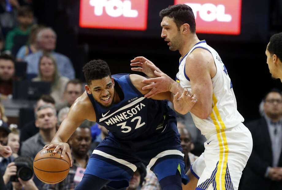 Minnesota Timberwolves' Karl-Anthony Towns, left, works his way around Golden State Warriors' Zaza Pachulia in the second half of an NBA basketball game Sunday, March 11, 2018, in Minneapolis. (AP Photo/Jim Mone) Photo: Jim Mone, Associated Press