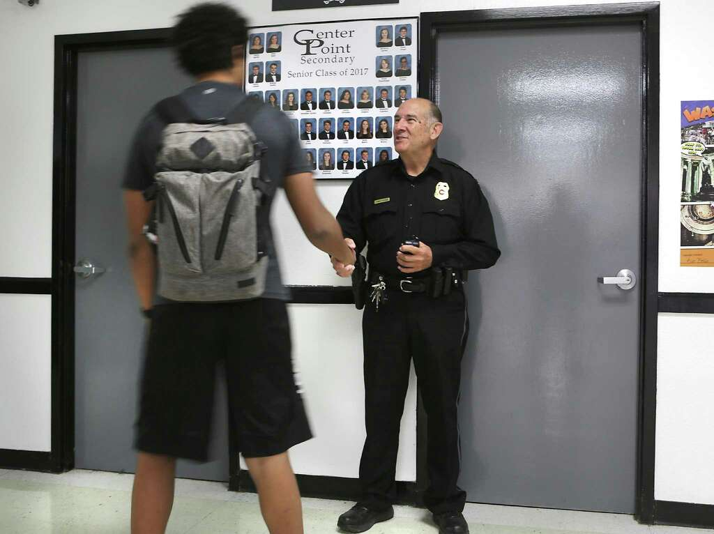 Center Point ISD's new police department is headed, solely by CPISD Police Chief Jimmy Poole, right, who greets students in the halls between classes, on Thursday, March 1, 2018. Photo: Bob Owen, Staff / San Antonio Express-News / ©2018 San Antonio Express-News