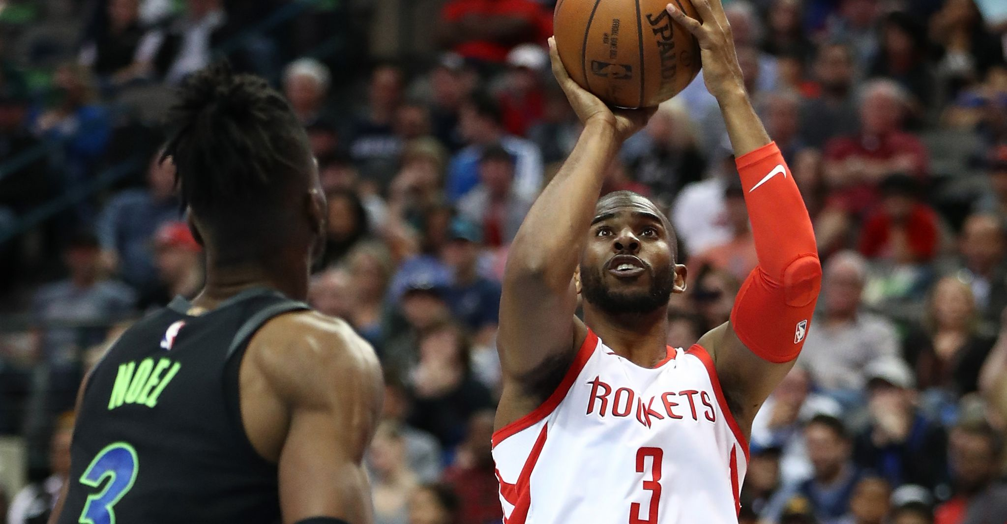 Rockets clinch playoff spot with rout of Mavericks