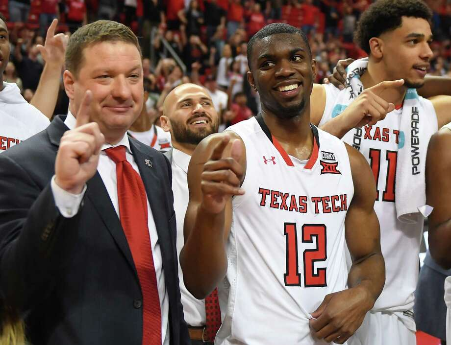 LUBBOCK, TX - MARCH 3: Head coach Chris Beard and Keenan Evans #12 of the Texas Tech Red Raiders stand on the court after the game against the TCU Horned Frogs on March 3, 2018 at United Supermarket Arena in Lubbock, Texas. Texas Tech defeated TCU 79-75. (Photo by John Weast/Getty Images) Photo: John Weast, Stringer / 2018 Getty Images