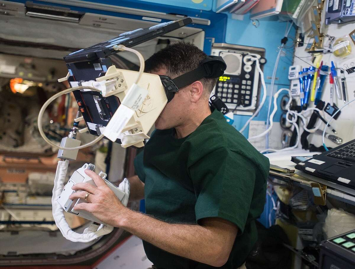 NASA astronaut Robert S. Kimbrough uses a virtual reality headset cobbled together from a laptop computer and a custom face mount aboard the ISS in December 2016. This setup is being replaced by newer VR headsets made by Oculus, which is similar to those used by gamers.